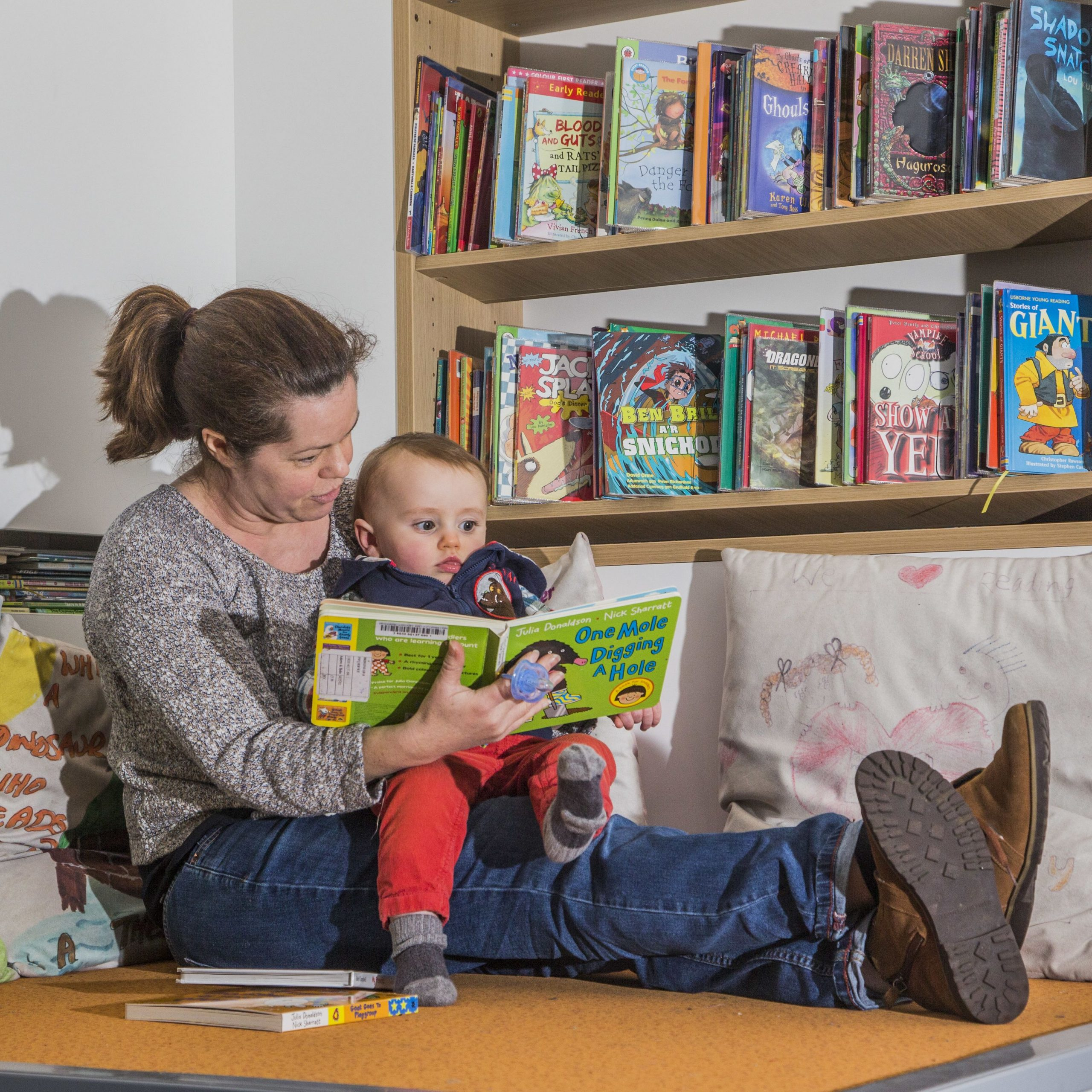 Mother and baby reading a book at Bridgend Libraries